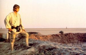 Luke Skywalker goes from bored farm-hand to intergalactic hero in the movie Star Wars.