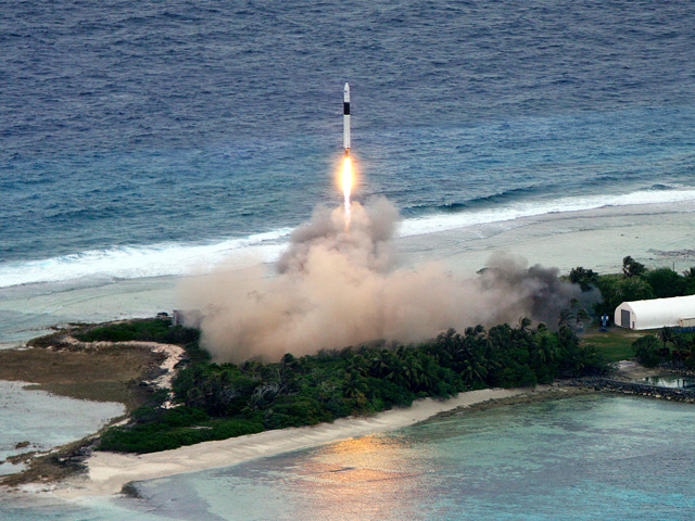A SpaceX Falcon 1 rocket begins a successful flight from Omelek Island.